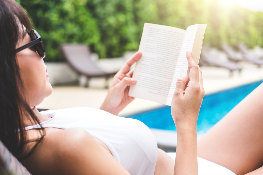 Sun, sand, and books! Are we reading more by the pool?